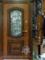 бронированные-двери-с-ковкой-и-лепниной-в-патине